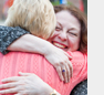 Two women hugging at Clark University Reunion 2016